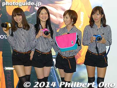Pentax/Ricoh had a bunch of girls posing for anybody.