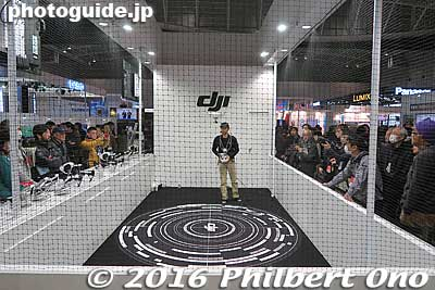DJI had a netted booth to demo an impressive flyng drone. Supposedly crash proof from dead batteries. It can also lock on to a fixed position so if any wind or bird knocked it, it would return to its fixed position automatically.